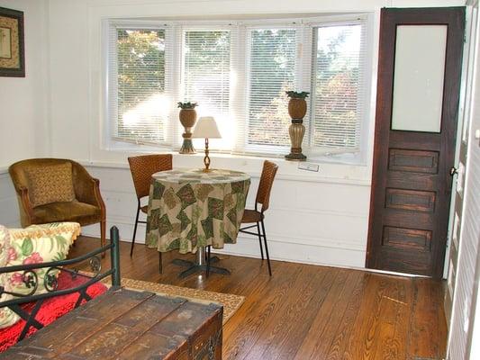 Safari Room Sunroom With Bay Window Sitting Area And