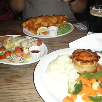 Fish and chips, potato wedges, and steak and ale pie (back to front)