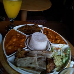 Mixed platter for 2: Chatpatta, chana/chicken masala, pakora, mixed curry, aloo palak, rice, naan + 2 juices, 1 mango cheesecake