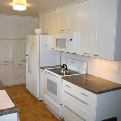 Full Kitchen Remodel In White With Cork Flooring And Under The Cabinet Countertops And Stove