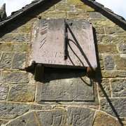 Sundial (1850) above porch (1718) with names of the Churchwardens