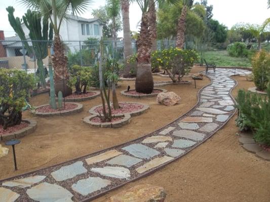 Flagstone walkway to backyard seating area Yelp