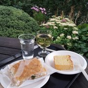 Rare grilled salmon and watercress foccacia, lemon drizzle cake, and pinot grigio for £12.15; beautiful view--priceless.