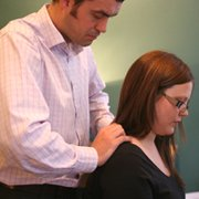 Sundial Chiropractor examining neck and shoulder joints
