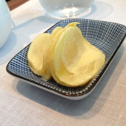 Slices of daikon with a mustard dressing.