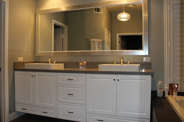 Custom double sink vanity whits cabinets pendents for Bathroom cabinets yelp