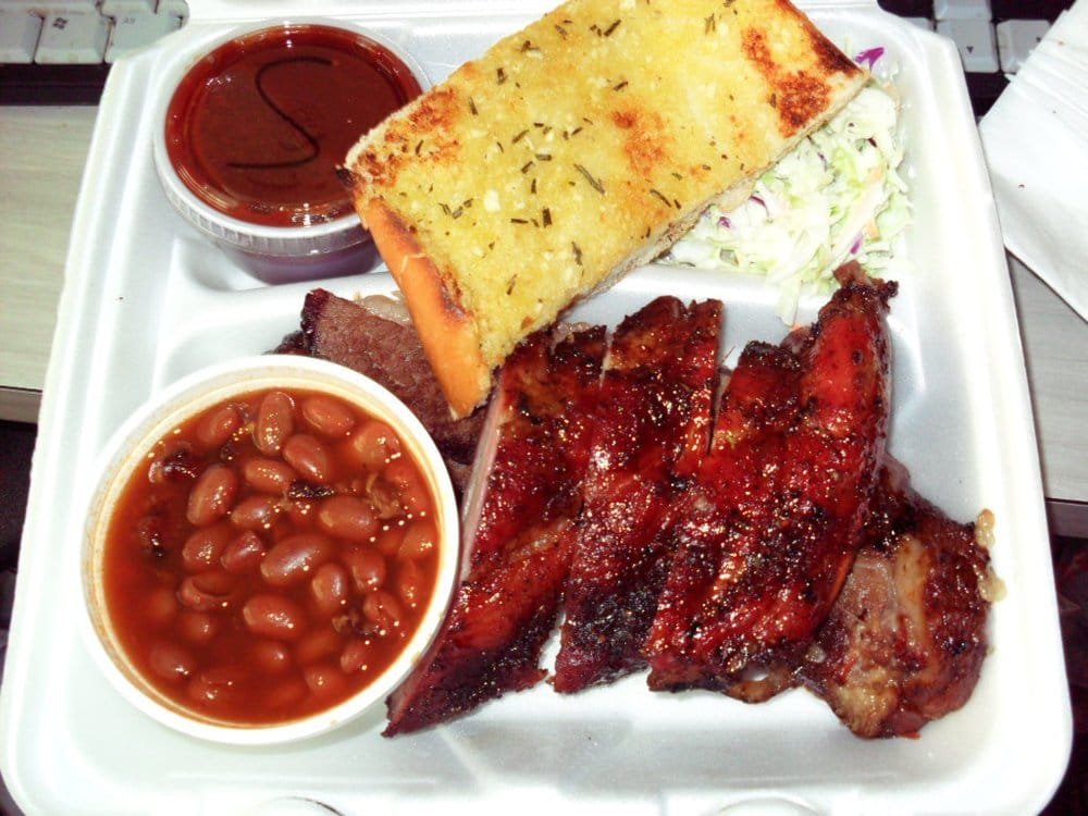 Brisket plate with warm BBQ sauce, baked beans, cole slaw