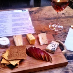La Fromagerie's French cheese board and rose.