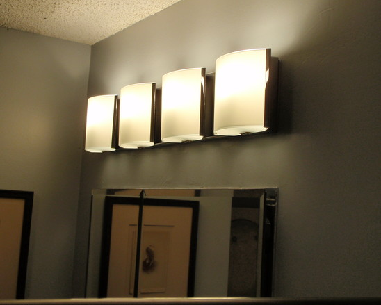 Bathroom: Muted Yet Bright Lighting Over Vanity Mirror