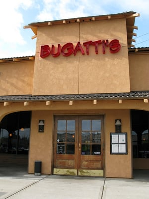 The main entrance doors to oc bugatti 39 s restaurant yelp for Bugatti pizza