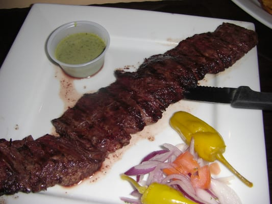 Entrana-Grilled skirt steak with chimichurri sauce rice and salad