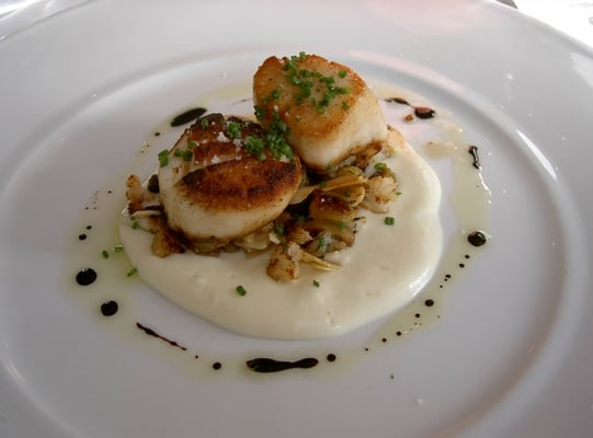 caramelized diver scallops with a cauliflower puree and almonds in a ...