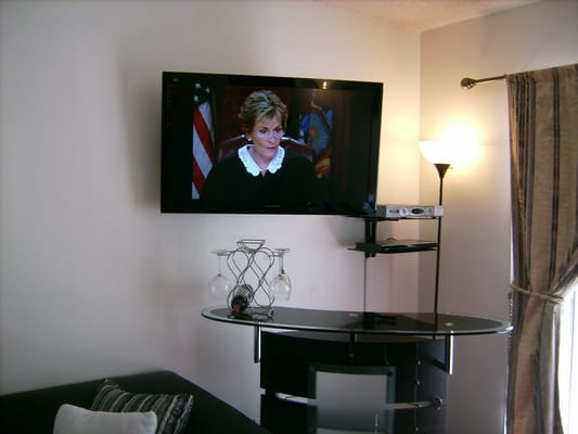 Premium TV Installation on a swivel wall mount above bar with ...