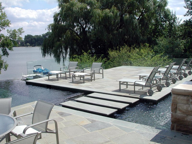 Bluestone infinity pool with patio deck negative edge for Garden oaks pool