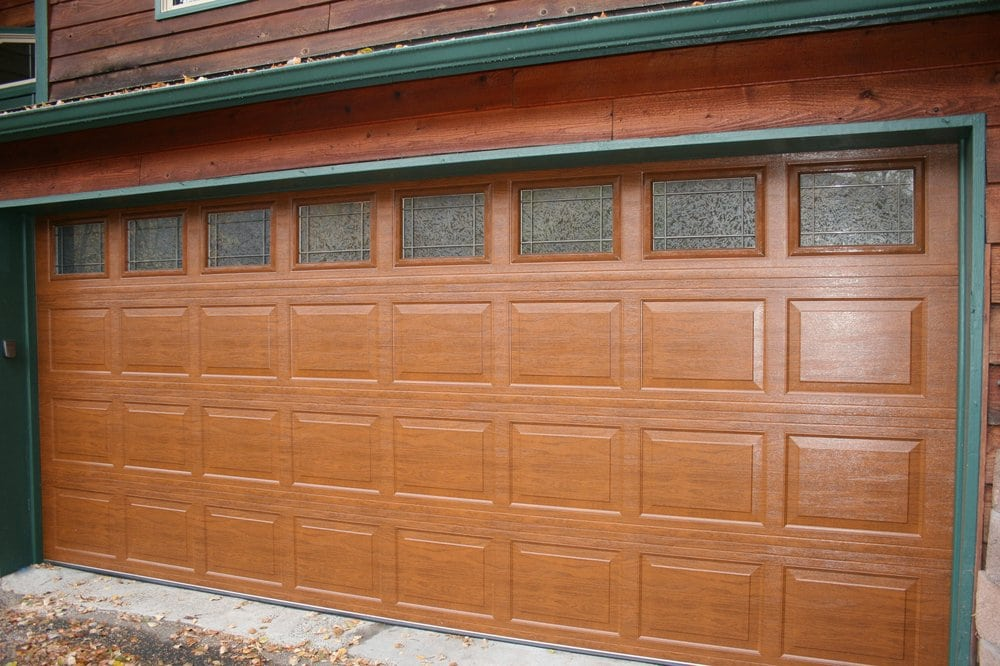 Elite wood look steel insulated garage door yelp for Wood looking garage doors