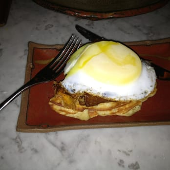 Duck & waffle, crispy leg confit with fried duck egg and mustard maple syrup.