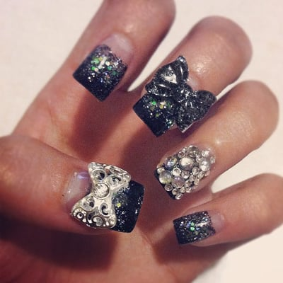 Acrylic nails. Clear base w/ black glitter gradient tips, glitters