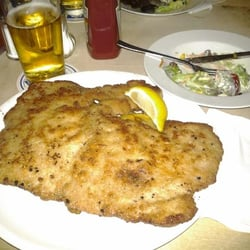 Schnitzel, side salad and a beer. The home fried potatoes are hidden underneath the schnitzel.