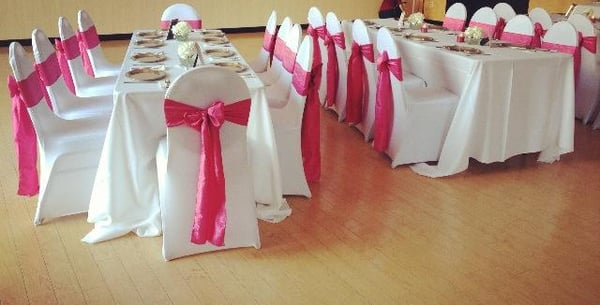 Our lovely White Spandex Chair Covers/Fuchsia Crinkled Taffeta Sashes for a beautiful 1st Birthday Party!!