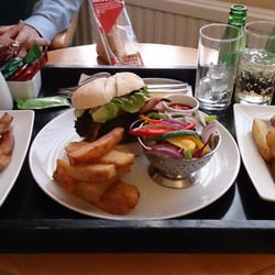 Delicious room service burger with proper chips!