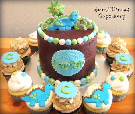 Sweet Dinosaur baby shower cake with coordinating cupcakes.