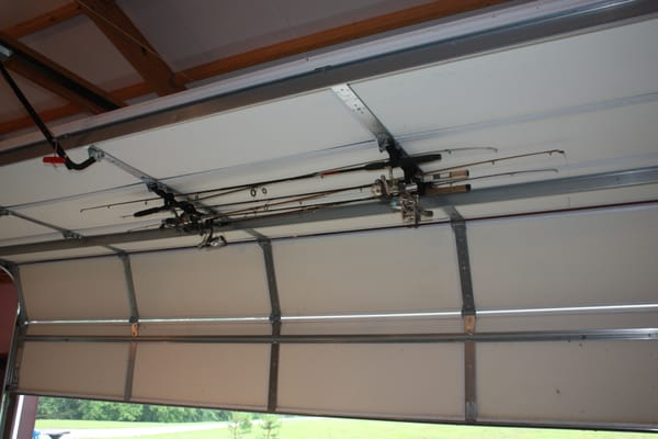 This Fishing Rod Rack Securely Fastens To Garage Doors And