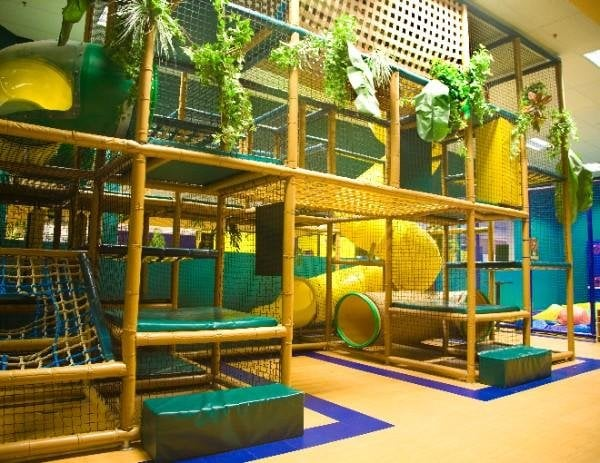 3 Level Indoor Playscape and Soft Play Area next to 2