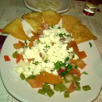 Napolitos salad with cactus, onion, tomatoes with cottage cheese