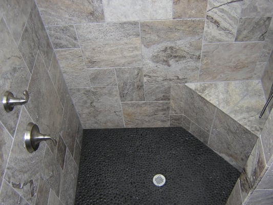 Black pebbles used for f shower floor yelp