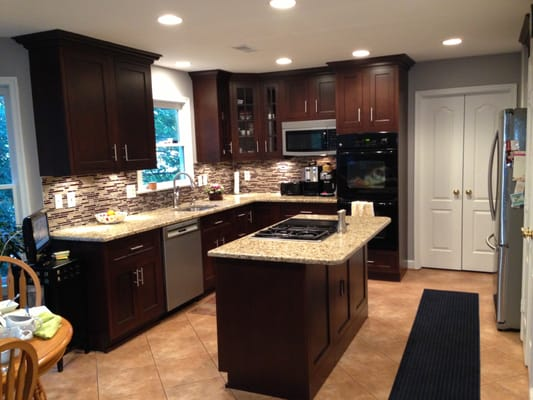 Dark Maple Cabinets w Medium Granite and Luxury Vinyl Tile  Yelp