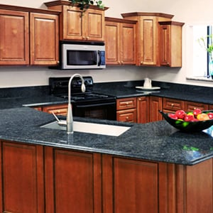 Maple Wood Cabinet With Blue Butterfly Granite Countertop