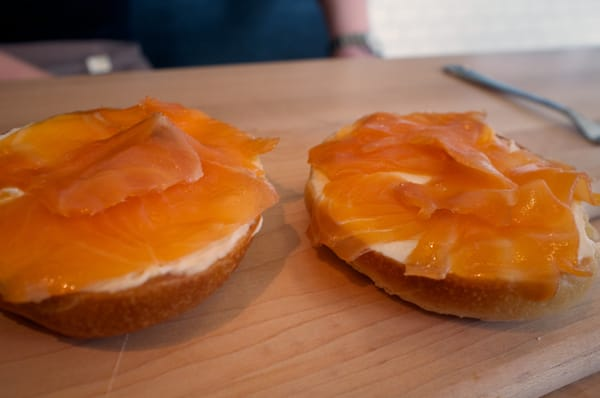 Smoked salmon, also known as lox, is acceptable to bagel purists.