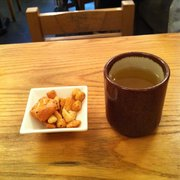 Complimentary Japanese rice crackers and tea