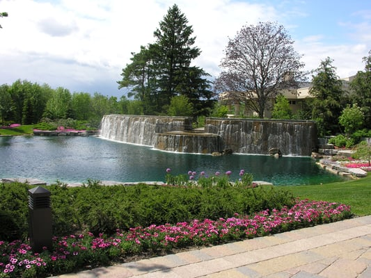 Large cascading waterfall with patio overlooking man made English gardens clinton township michigan