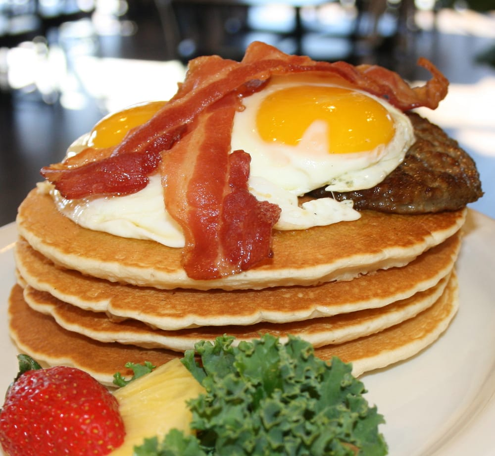 Pancake Breakfast Tower. Stack of Pancakes, two Bacon Strips two ...