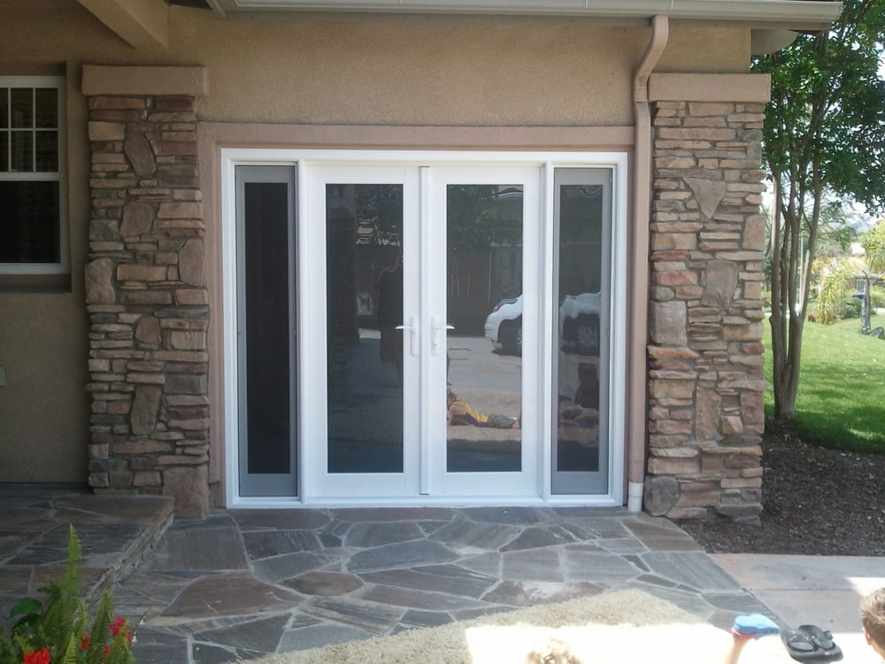 Garage door converted into french door with two side for Convert two door garage into one