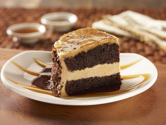 ... Chocolate cake layered with butter cream, topped with salted caramel