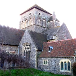 Norman tower from the north-east, with Victorian vestry (centre) and sensitive modern extension (right).