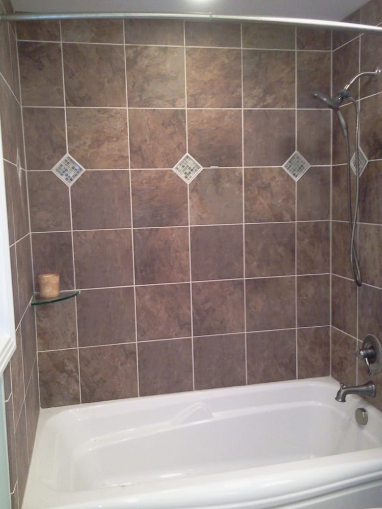 Tub shower combo custom tile surround with keys yelp for Bathroom ideas with tub and shower