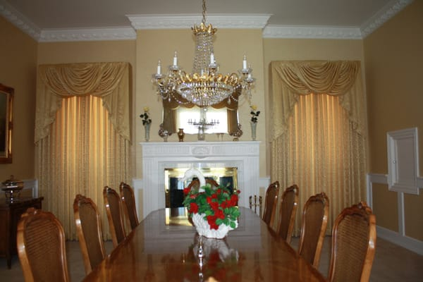 Updated elegant dining room with swags and cascade draperies ...