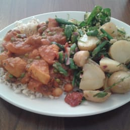 Butternut squash tagine on brown rice, potato salad and bulgar salad