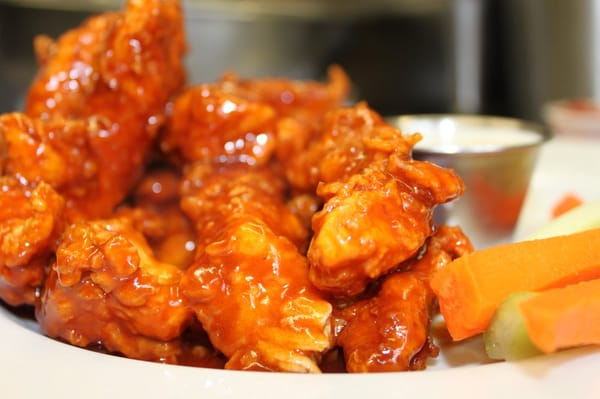 Our Signature Boneless Buffalo Wings, served with homemade bleu cheese ...