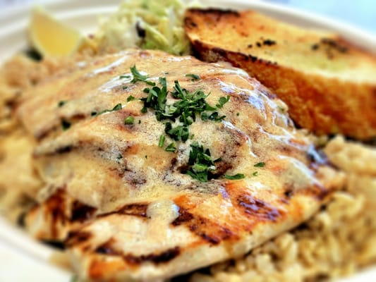 Grilled mahi mahi with garlic butter sauce and brown rice for Fish dish burbank