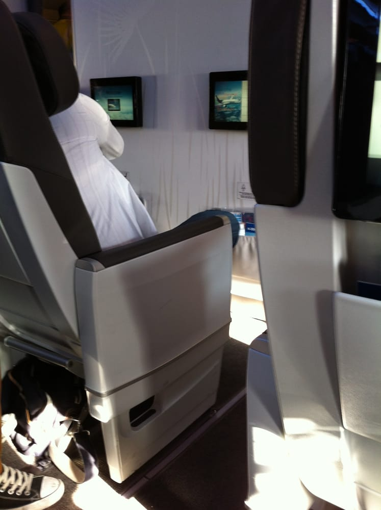 new club class seats in air transat looking at row 1 note the tv s are on the wall and farther