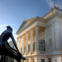 "View of the Royal Opera House taken from across Bow Street (statue of ""the little dancer"" in the foreground)."