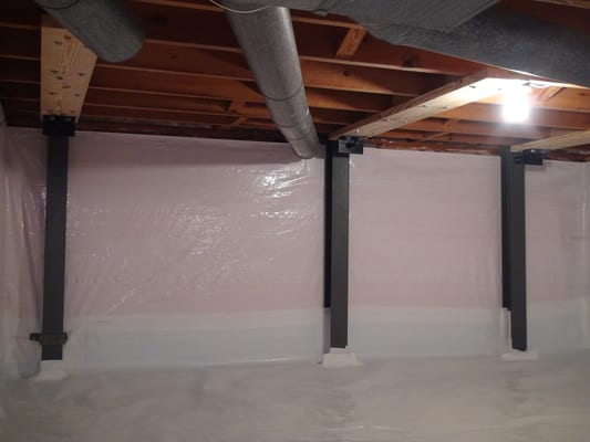 crawl space repaired with whitecap vapor barrier and force bracket