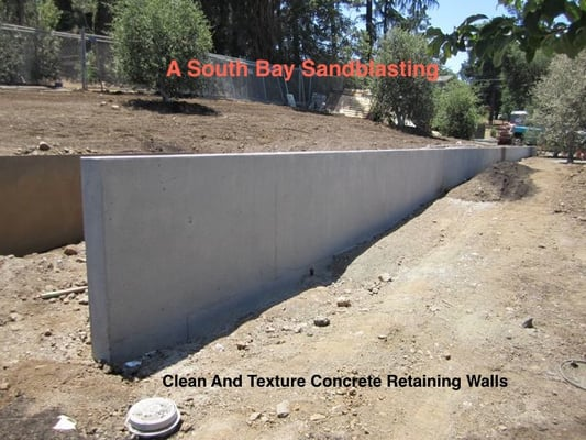 Concrete retaining wall blast textured to architectural