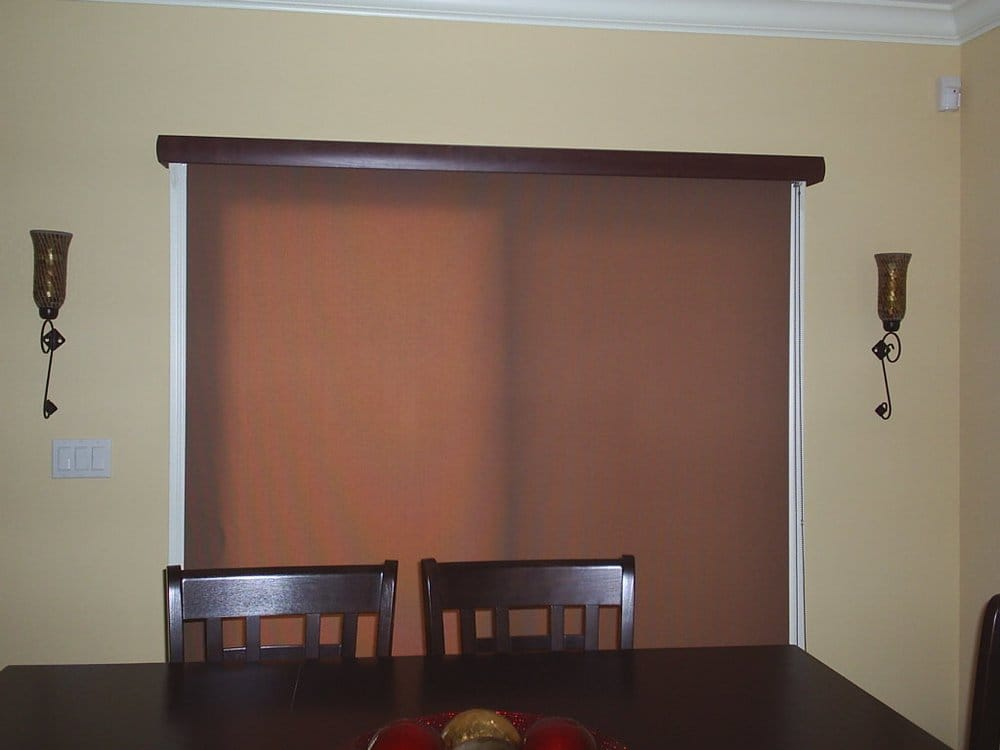 Roller Shade Covered With A Wood Valance Over The Slidding