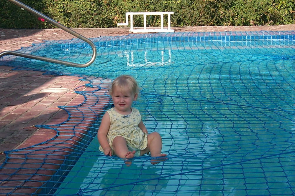 Child on pool safety net yelp - Swimming pool safety covers inground ...