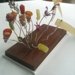 Amuse-bouche number 1: a selection of artfully displayed tiny cones made of local veggies prepared different ways.
